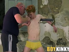 Mature freak plays with his submissive slave in the dungeon
