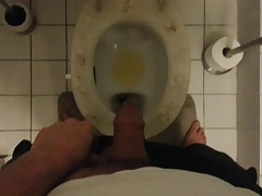 Pissing on toilet