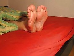 my sexy naked feet on the bed